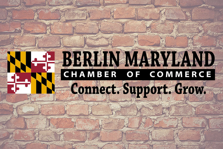 Berlin Maryland Logo in front of brick