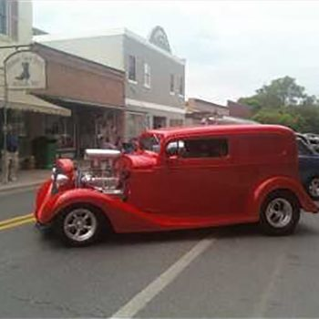 Red hot rod in street
