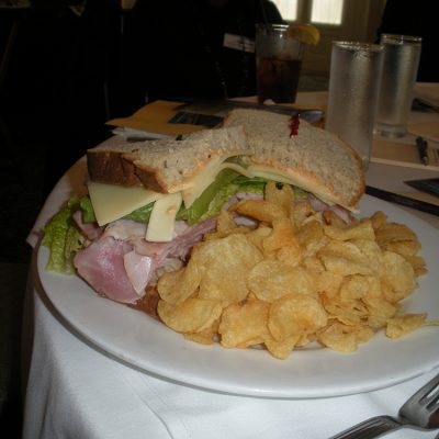 A large sandwich with potato chips