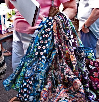 A woman with a bunch of multicolored bags