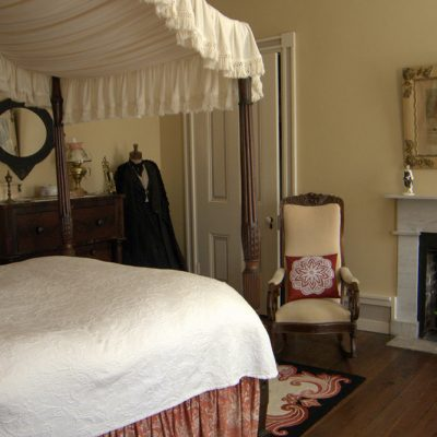 A bedroom with fireplace and dress