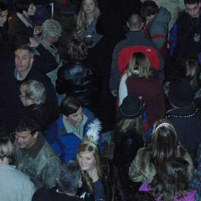 A large crowd of people socializing